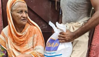 A flood victim receiving monthly rations